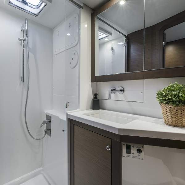 Private bathroom with electric toilet